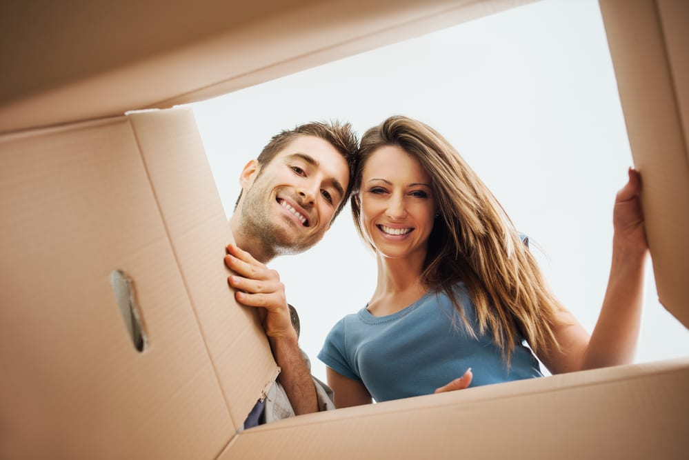 couple looking inside a cardboard box